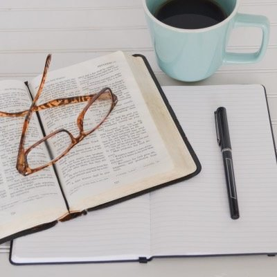 Bible, glasses, book & pen