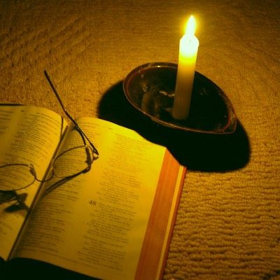 Image of Candle, Bible & glasses